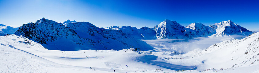 Winter mountains, panorama - ski slopes in the Italian Alps