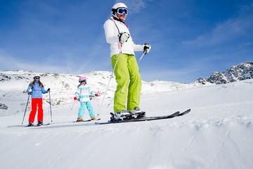 Skiing, winter - skiers on mountainside