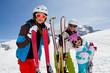 Skiing, winter fun - happy skiers on ski holiday