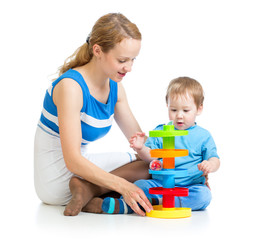 baby boy and mother playing together with puzzle toy