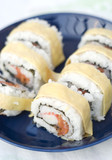 Crab and salmon sushi with egg layer