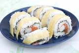 Crab and salmon sushi with a layer of egg
