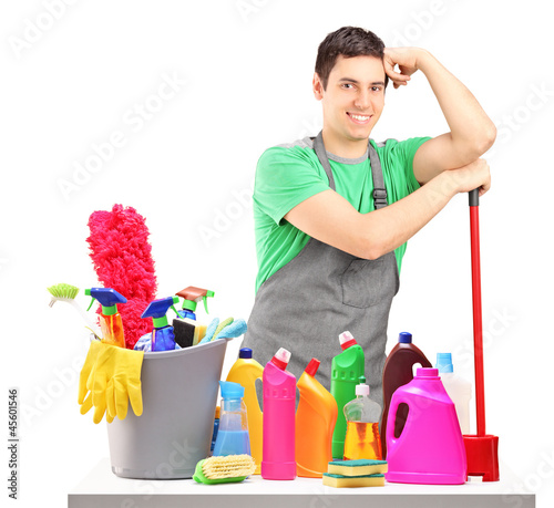 Young male cleaner with cleaning equipment isolated on white