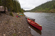 Tents and canoes at McQuesten River Yukon Canada