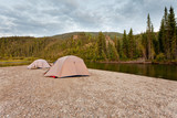 Tents at river in remote Yukon taiga wilderness