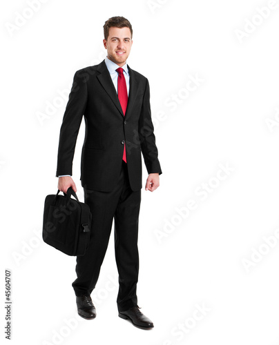 Full length businessman holding a briefcase
