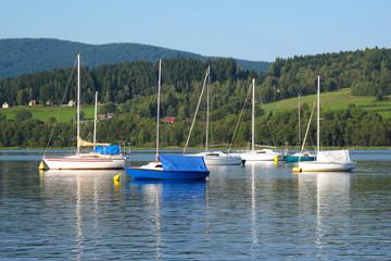 Sailing boats on lake Lipno, Bohemian Forest, EU.