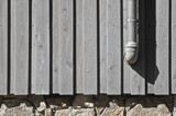 Wooden facade, rubble masonry and downpipe poster
