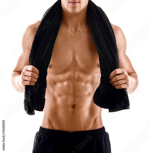 Sexy body of muscular athletic man with towel on the shoulders