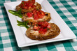 Plate of fresh bruschetta with tomatoes