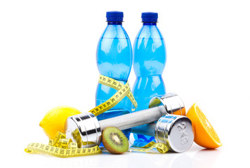 fitness equipment, water and fruits