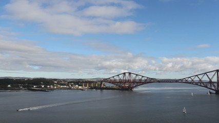 Boats on Firth of Forth with Forth Rail Bridge Scotland