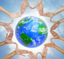 Hands forming  a circle with planet Earth in center