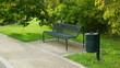 Leinwanddruck Bild - grüne oase mit einer grünen parkbank aus metall