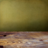 Background with wooden tabletop and grunge green wall poster