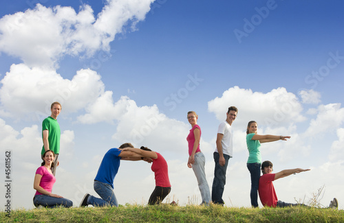 Group of people spelling word LOVE outdoors in nature