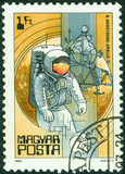 stamp printed in Hungary shows astronaut Armstrong, apollo