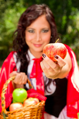 Little Red Riding Hood offering you an apple