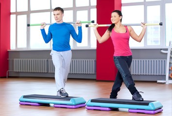 Man and woman at the gym doing stretching