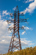 High-voltage tower on blue sky background.