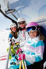 skiing - happy skiers on ski lift