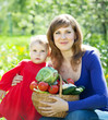 Woman and baby  with  harvested vegetables