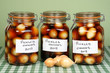three jars pickled onions