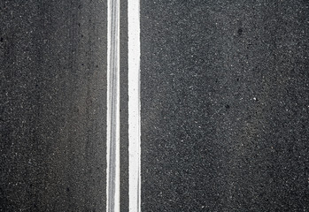 Close-up texture of an asphalt road with marking