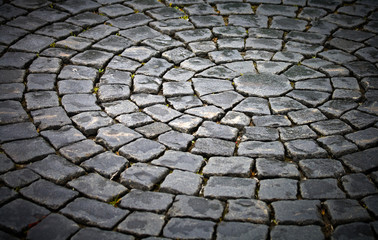 Background texture of round cobblestone pavement square