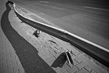 Damaged barrier on the highway. Black and whit photo