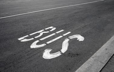 Bus stop label on the asphalt road