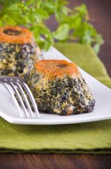 Spinach cakes on white dish.