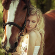 beautiful girl hugging a horse