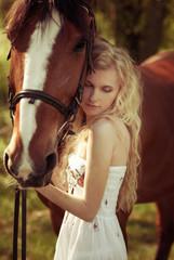 beautiful girl hugging a horse