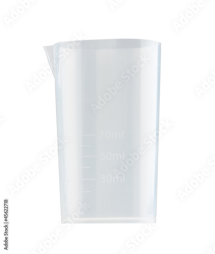 Clear measuring cup for bakery preparing isolated on white backg