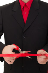 man cutting the red ribbon with scissors