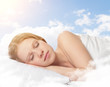 Leinwanddruck Bild - beautiful young woman sleeping on a cloud in the sky