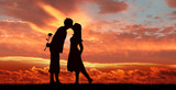 Romantic couple on the sunset background.