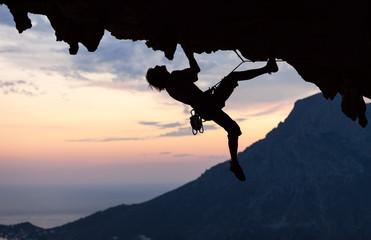 Silhouette of a rock climber at sunset. Kalymnos Island, Greece.