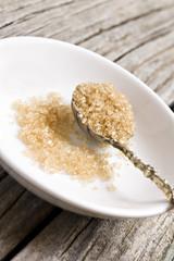 a Sugar spoon with brown sugar