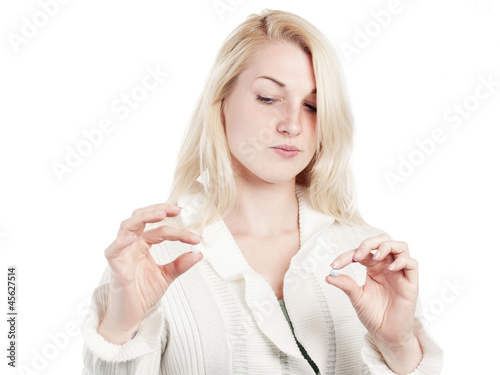 Young woman can not decide on choice of medication - isolated