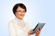 Portrait of senior woman with digital tablet