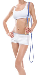 Young fitness woman with skipping rope