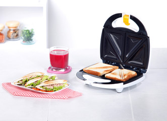 sandwich maker machine in the kitchen