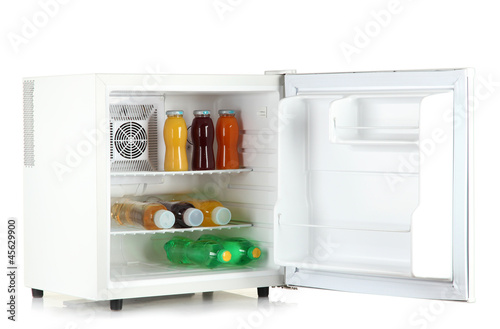 mini fridge full of bottles of juice, soda and fruit isolated