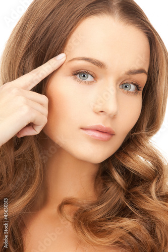 beautiful woman pointing to forehead