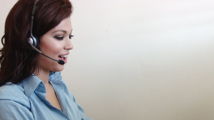 Happy young customer service worker woman