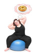 Overweight woman practising with ball and her sweet dreams.