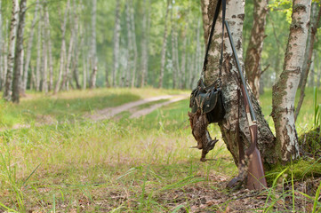 Shot-gun and trophy, outdoors