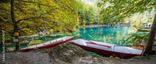 Red Boats By The Lake